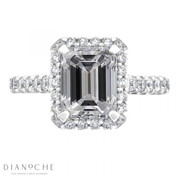 Emerald cut halo engagement ring white gold